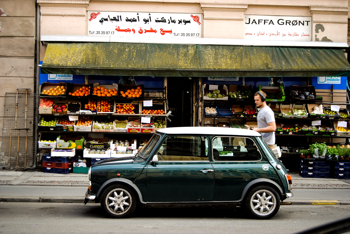 This picture didn't quite turn out the way I visioned it, but it has many elements that can be found in Copenhagen: small cars, fruit shops, Arabic texts and young urban people.